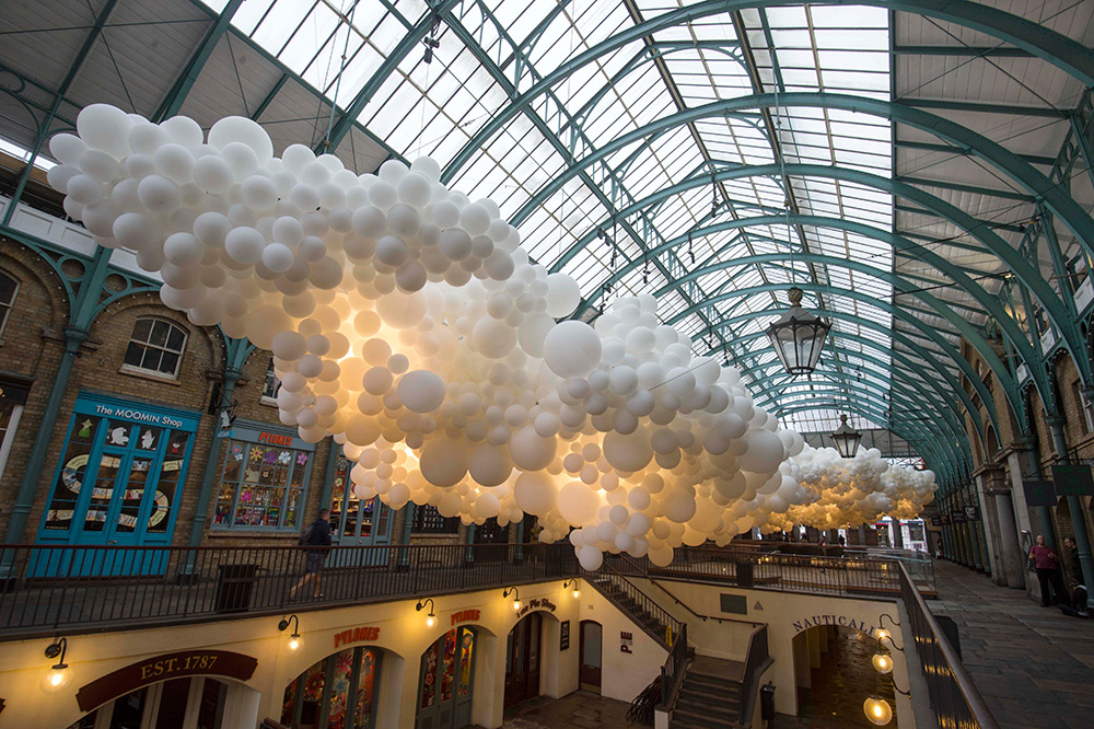 A Cloud of 100,000 Illuminated Balloons Suspended Inside Covent Garden by Charles Petillion