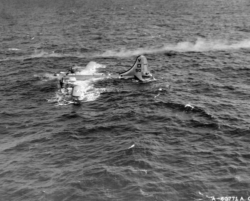 """When crippled, the largest things are most helpless!  This 499th Bomb Group Boeing B-29 """"Seperfortress"""" had to ditch off shore.  Iwo Jima, Bonin Islands."""