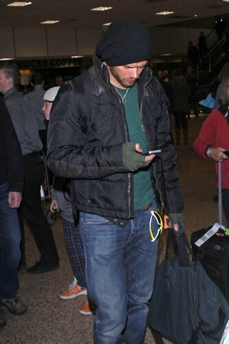 Kellan Lutz stays glued to his iPhone as he arrives in Park City for the 2014 Sundance Film Festival
