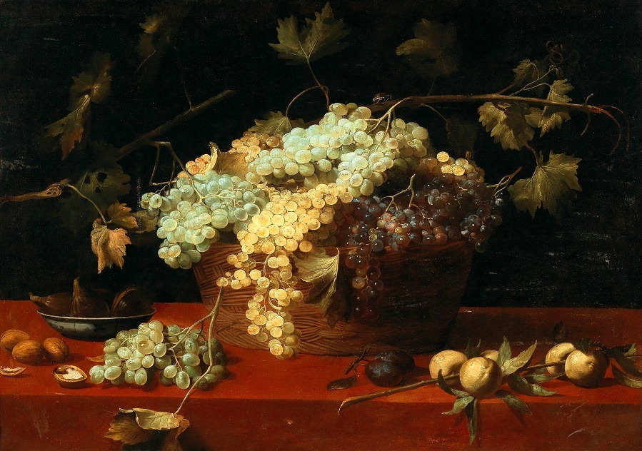 A still life with grapes in a basket