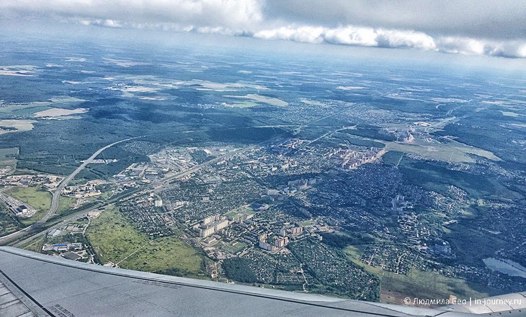 вид на Россию из окна самолета