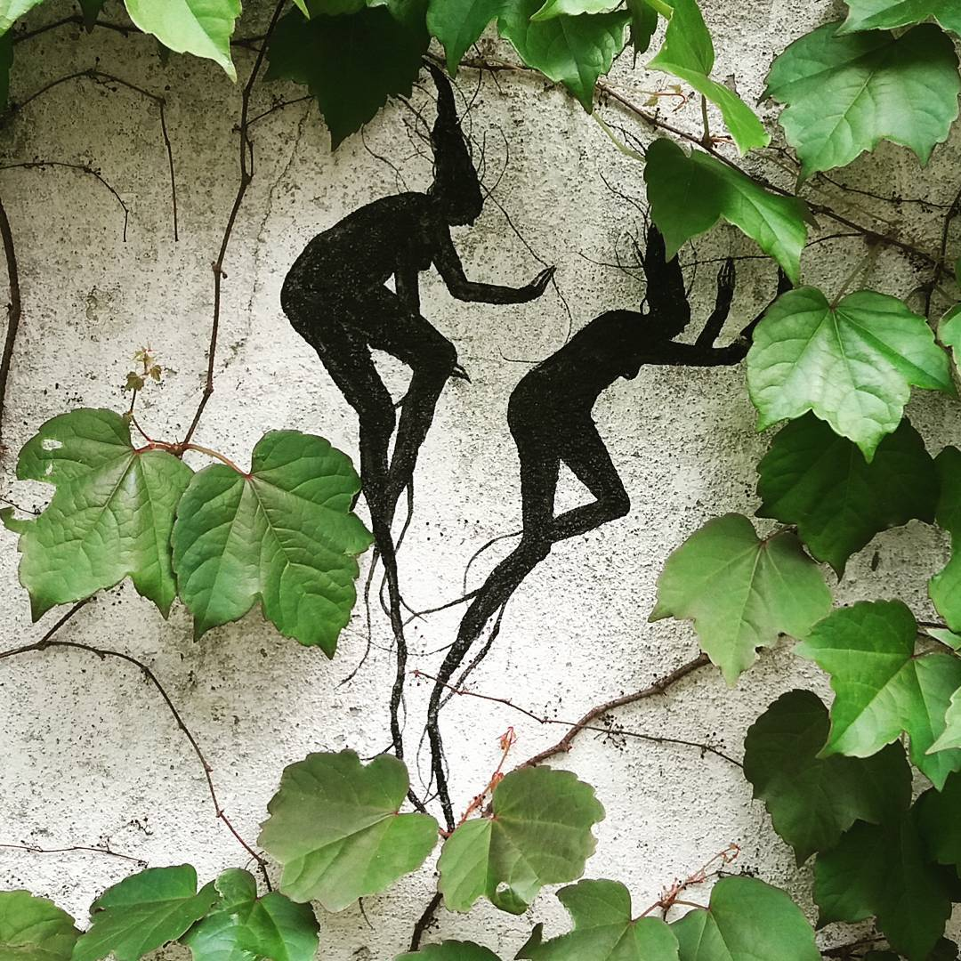 Figures in Silhouette March Across Building Facades in New Murals by David de la Mano