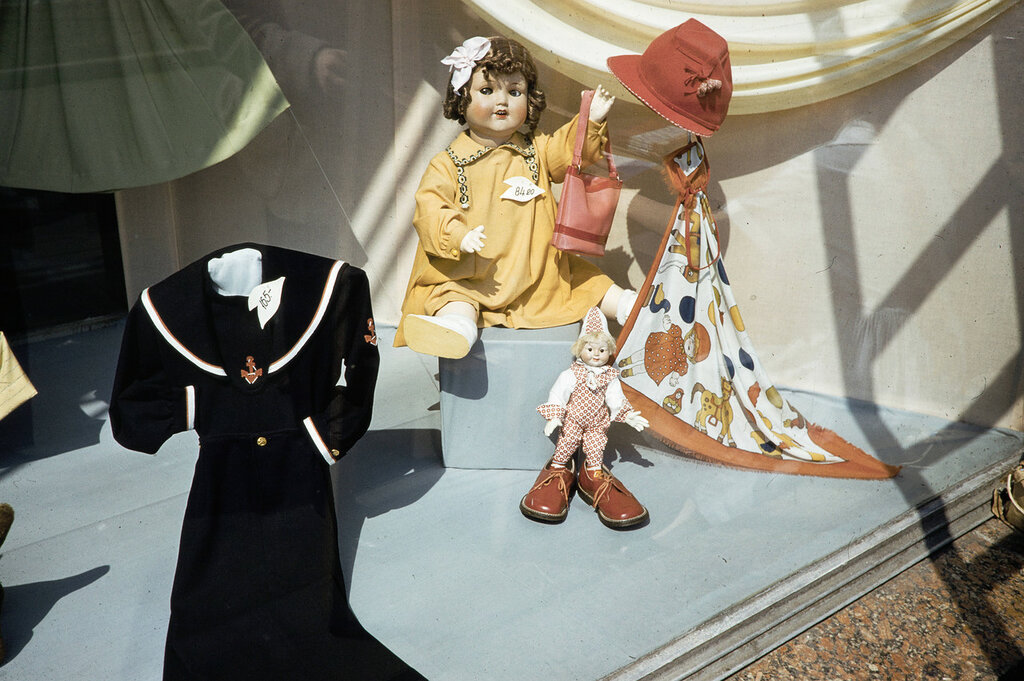Russia, dolls and children's clothes in window of Moscow store