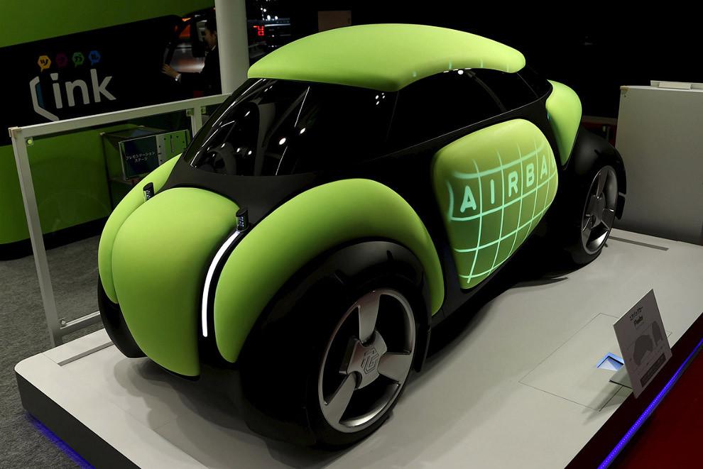 4. Прототип городского электромобиля COMS Connect от Тойоты. Разработкой концепт-кара занимался аним