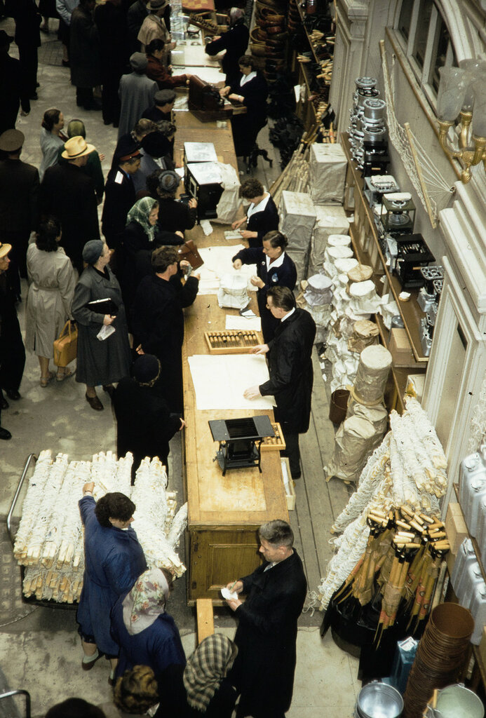 Russia, clerks selling goods at GUM Department Store in Moscow