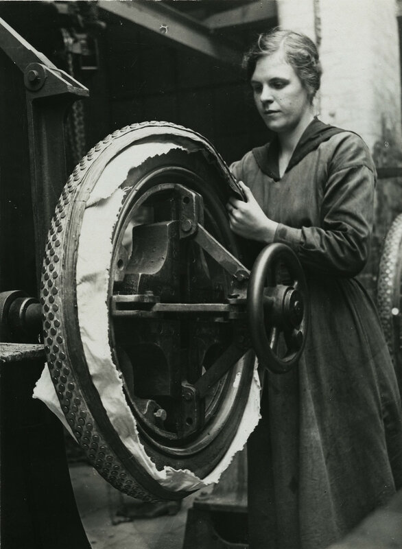 British women rubber workers in Lancashire fixing studded tires