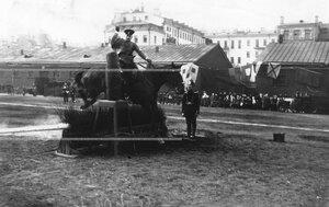 Конные состязания в бригаде на плацу рубки чучела с одновременным преодолением барьера.
