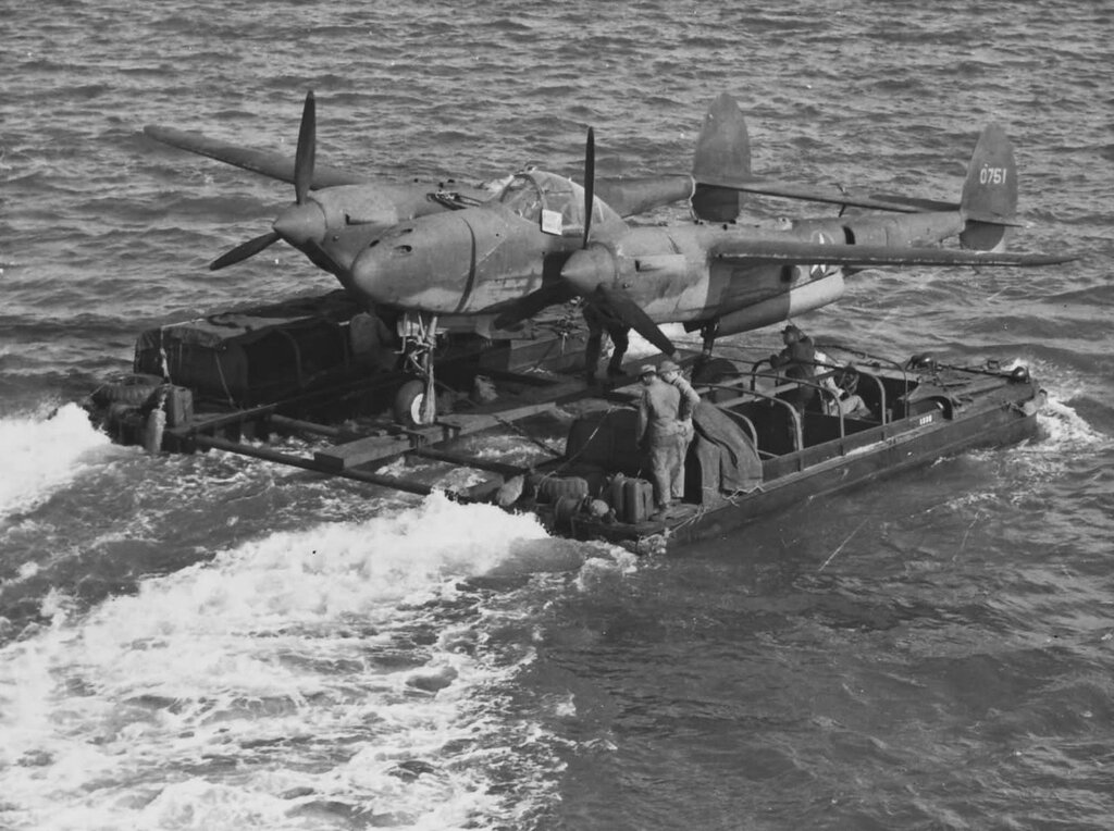 P-38 Lightning carried by two DUKW's.
