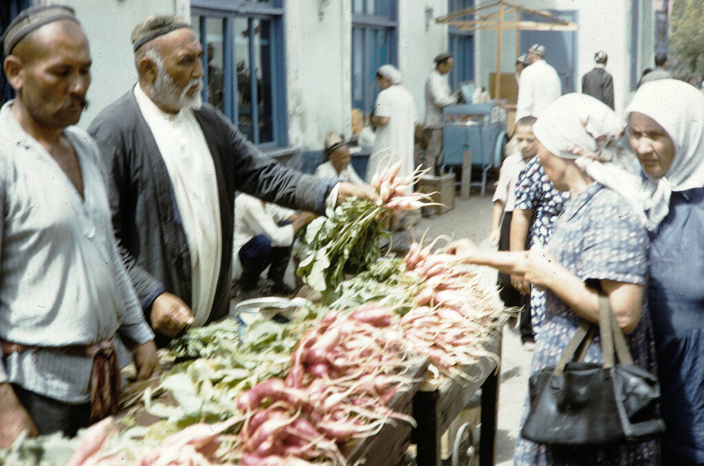 Kazakhstan, merchant selling radishes at market