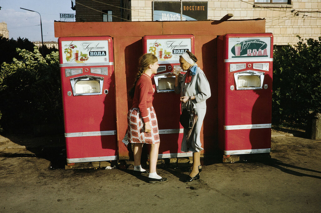 Russia, women purchasing soft drinks from vending machine in Moscow