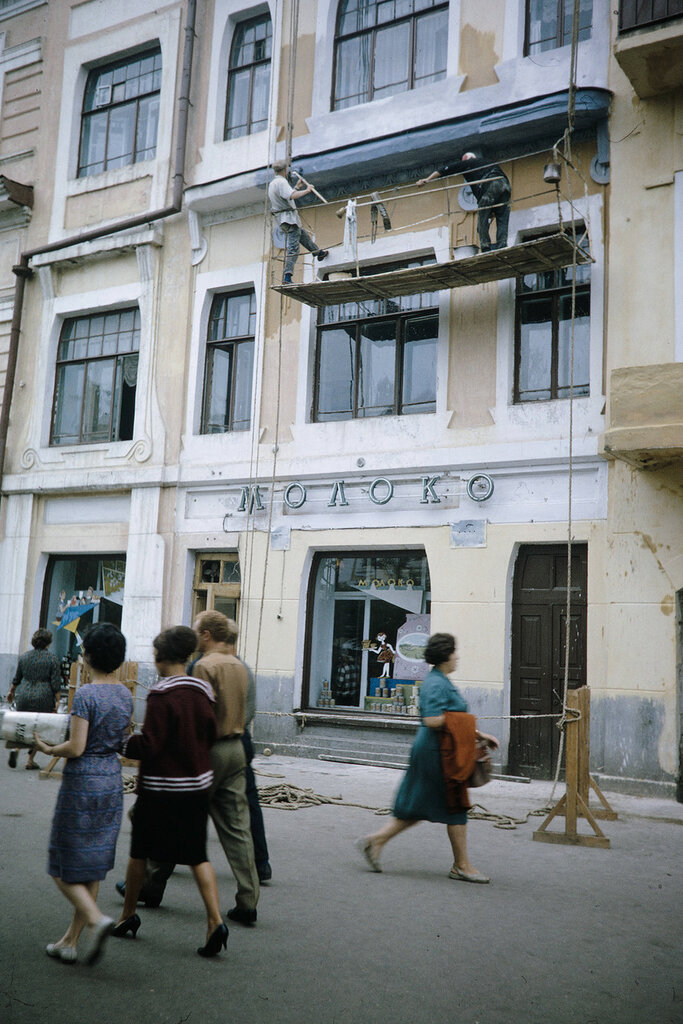 Russia, men painting commercial building in Khabarovsk