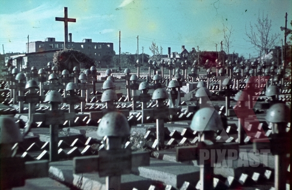 stock-photo-war-time-color-photo-of-italian-military-graves-graveyard-with-helmets-and-cross-in-ukraine-1942-7960.jpg