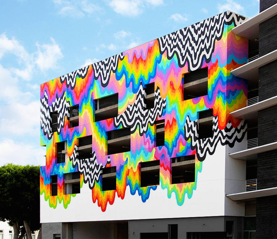 Vibrant Melting Paint Mural on a Mall Facade