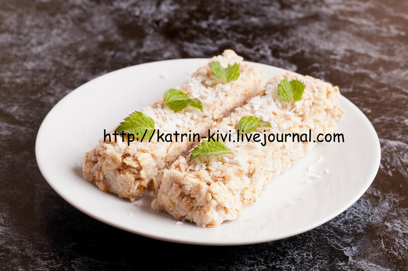 oat bar with coconut with mint on a plate, close up