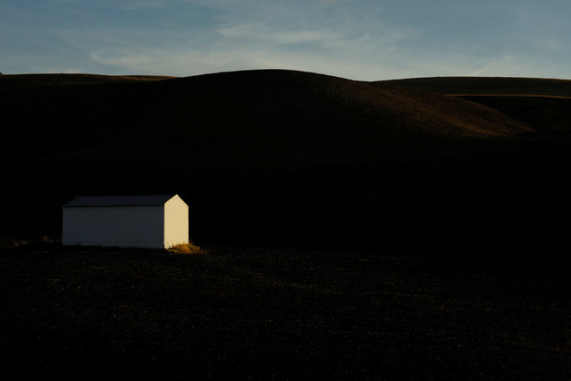 A warehouse is pictured in a field near the white village of Setenil de las Bodegas, southern Spain