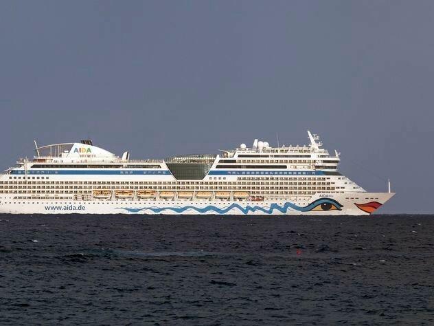 AIDA cruise ship sailing along the coast of Fuerteventura, Canary Islands, Spain, Europe - ibxhal04343481.jpg