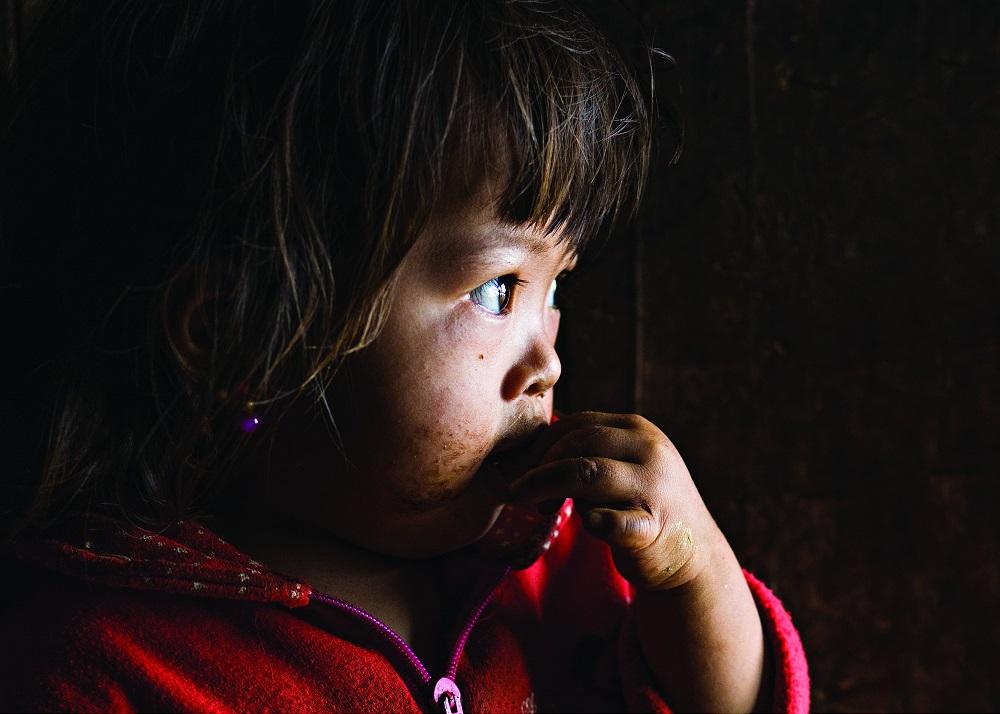 Ребенок в деревне Бак Ха.
