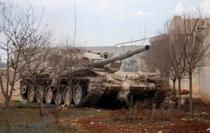 A Syrian Army soldier loyal to Syria's President Bashar al-Assad is pictured in a tank in Ard al-Hamra in Aleppo