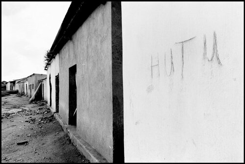 RWANDA. 1994. Hutus living in this house scrawled their ethnicty on the wall to prevent looting. The advance of the rebel Rwandan Patriotic Army caused the Hutus to flee in turn.