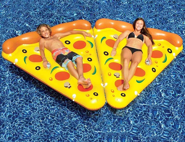 An inflatable pizza for sunbathing at the beach