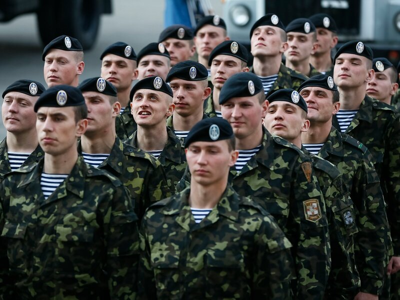 Ukrainian marines attend a welcoming ceremony after their return from a Ukrainian military base in the Crimean port city of Feodosia, in Kiev