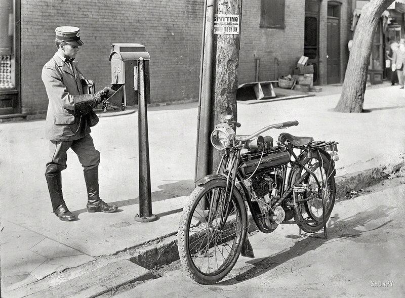 Circa 1915, location unknown. Mailman & motorcycle