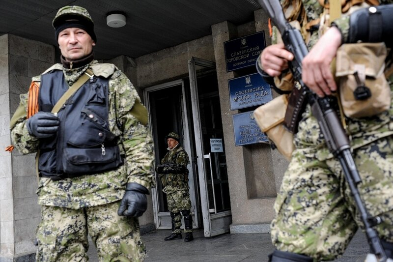 Armed pro-Russian activists seize the Ukrainian regional administration building in the eastern Ukrainian town of Slovyansk, Ukraine, Monday, April 14, 2014. A pro-Russian mob also stormed a Ukrainian police station in Horlivka, another city near the Russ