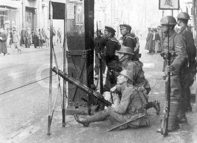 Soldiers Aiming Gun On City Street