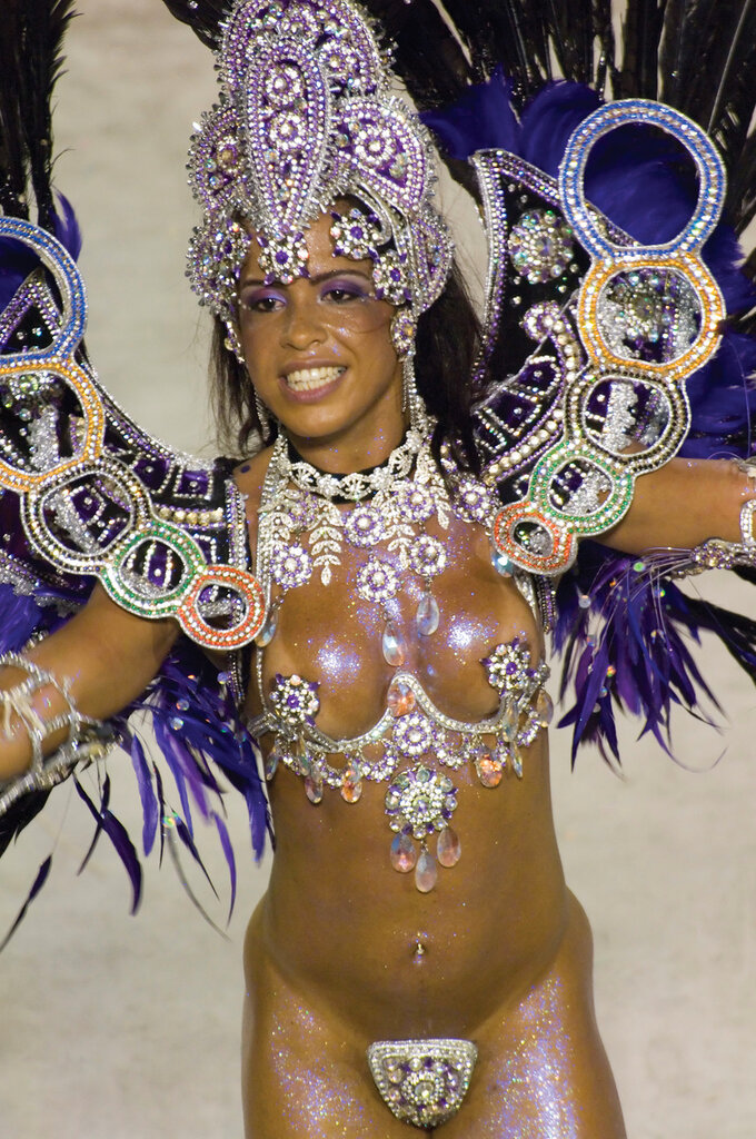 South America, Brasil, Brazil, Rio De Janeiro,February 2007.A closer view of one of the participants in the parade.  Carnival in Rio has been called the world's most famous party. A million tourists join millions of Rio de Janeiro citizens (