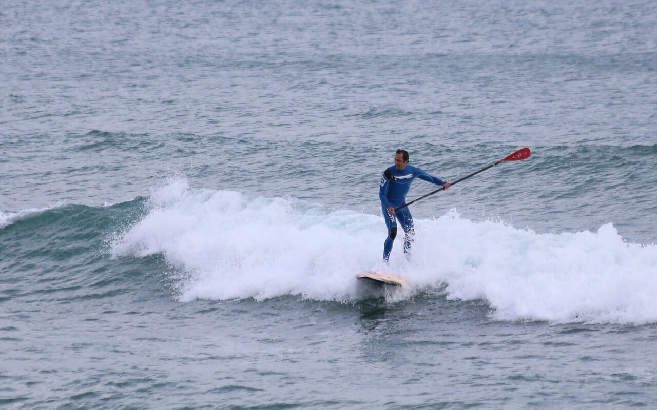 Barcelona. Barceloneta. The Beach Of San Sebastian. surfing. (Platja de Sant Sebastià). surfing