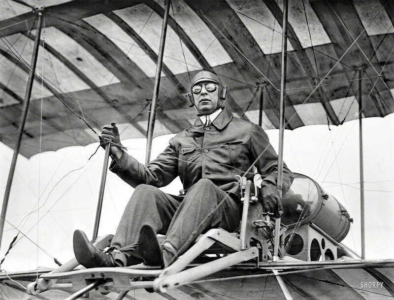 July 1910. New York. Clifford B. Harmon seated in aeroplane. Aviator and land developer