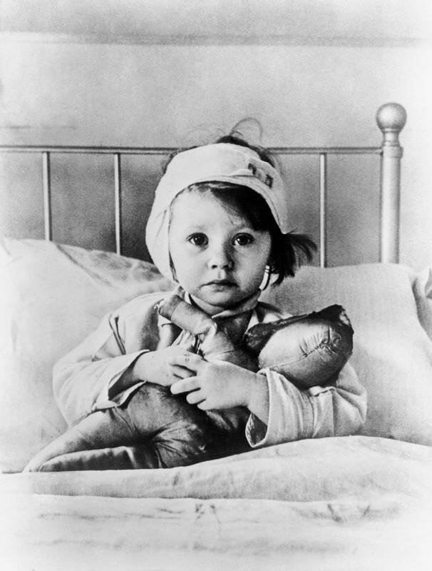 Three-year-old Eileen Dunne with her doll at Great Ormond Street Hospital for Sick Children after surviving a German air raid on London, September 1940
