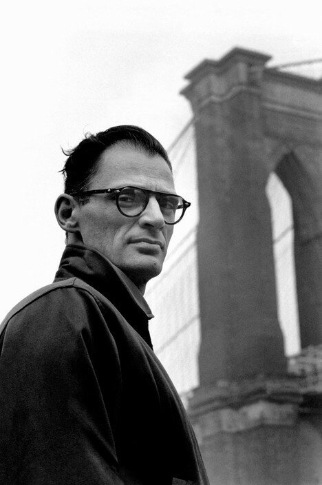 USA. New York City. 1954. American writer Arthur MILLER in front of the Brooklyn Bridge.jpg