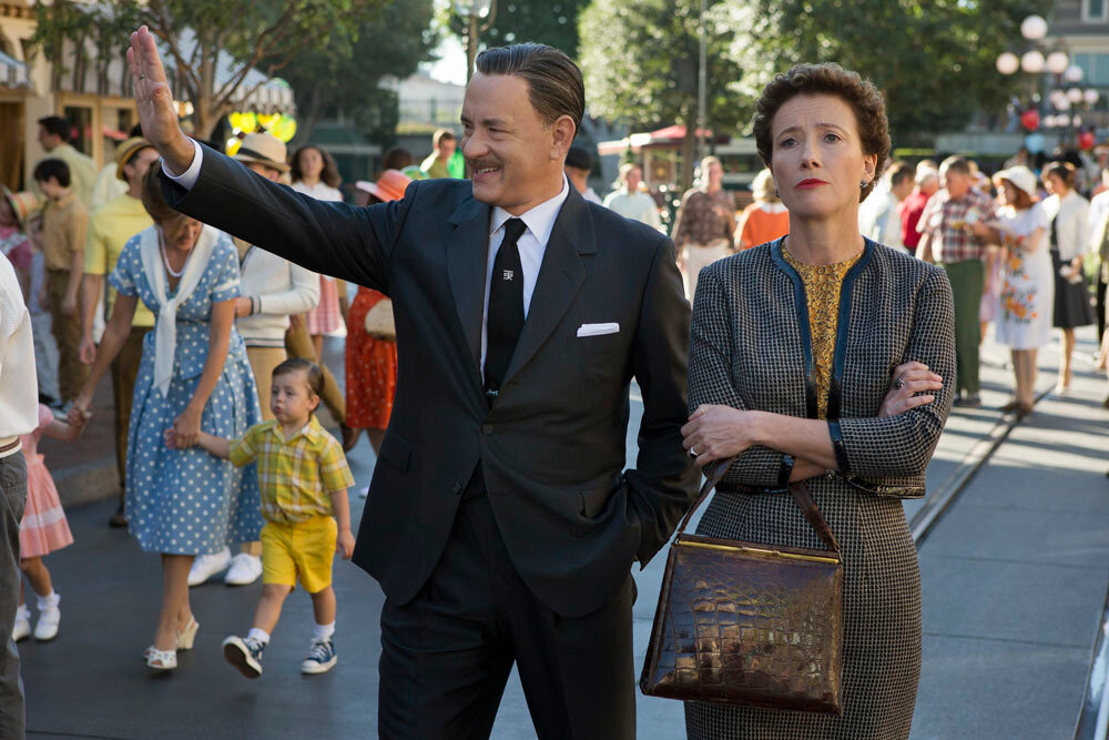 """""""SAVING MR. BANKS""""SMB_05582FDWalt Disney (Tom Hanks) showsDisneyland to """"Mary Poppins"""" author P.L. Travers (Emma Thompson) in Disney's """"Saving Mr. Banks,""""releasing in U.S. theaters limited on December 13, 2013 and wide on December 20, 2013.Ph:"""