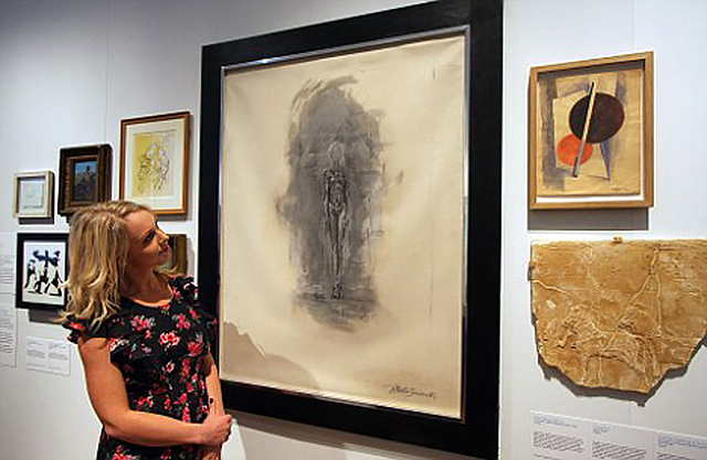 The V&A host an exhibition by the Police of recent art forgeries by infamous forgers....John Myatt's Alberto Giacometti Standing Figure forgery pictured Riah Pryor from the Art forgery squad