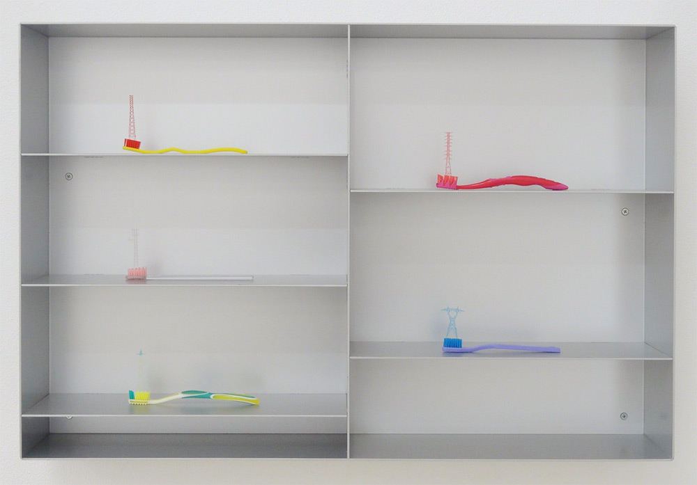 Miniature Power Line Towers Sprout from the Bristles of Toothbrushes by Takahiro Iwasaki