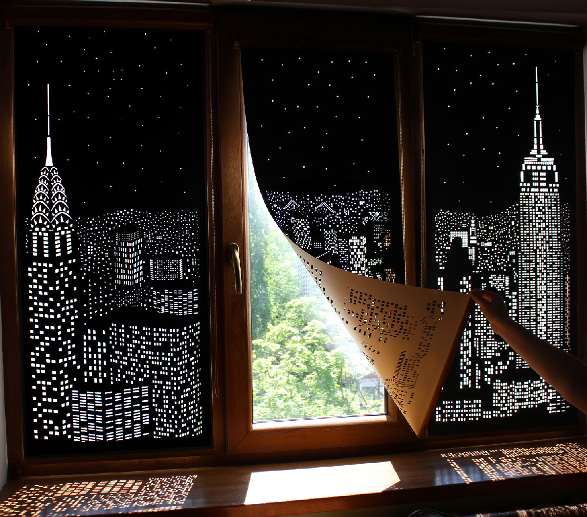 Buildings and Stars Cut into Blackout Curtains Turn Your Windows Into Nighttime Cityscapes (5 pics)