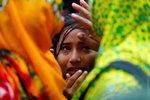 Родственники жертв, погибших при обрушении здания Rana Plaza в 2013 году, скорбят во время четвертой годовщины в Саваре на окраине Дакии, Бангладеш. 24 апреля 2017 года. Фото: Mohammad Ponir Hossain / REUTERS     BANGLADESH-DISASTER/ANNIVERSARY