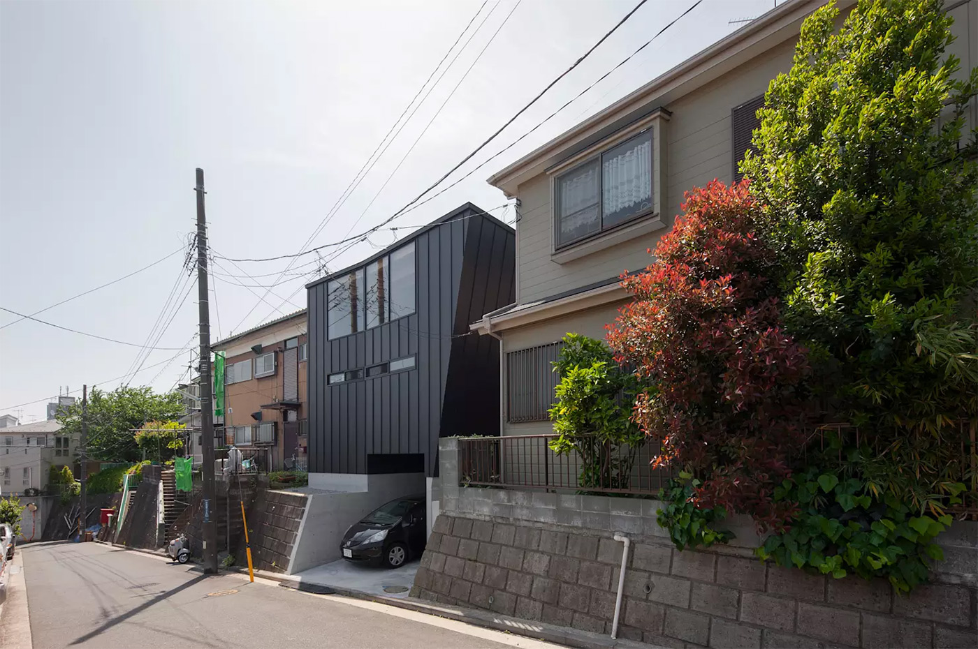A Japanese Home Designed Around a Climbable Earthquake-Proof Bookshelf