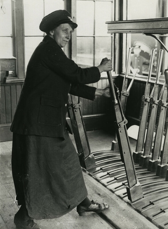 Railway worker pulling signal box levers