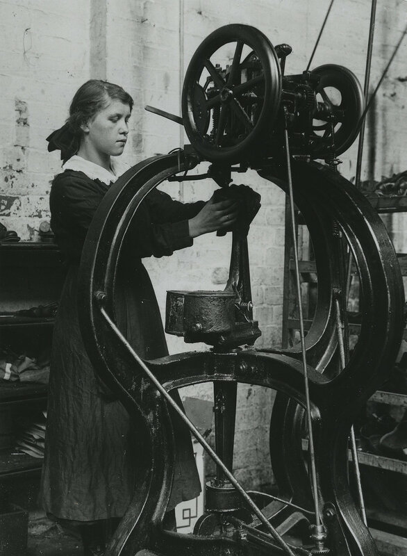 Girl operating stitching machine in Leicestershire boot factory