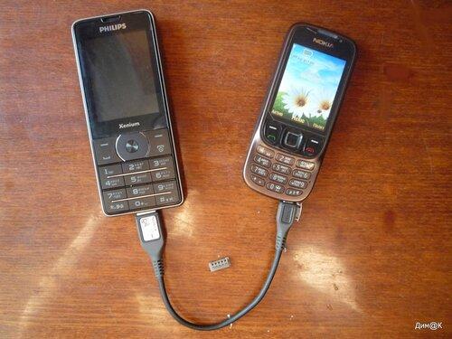 Philips Xenium X1560 заряжает телефон