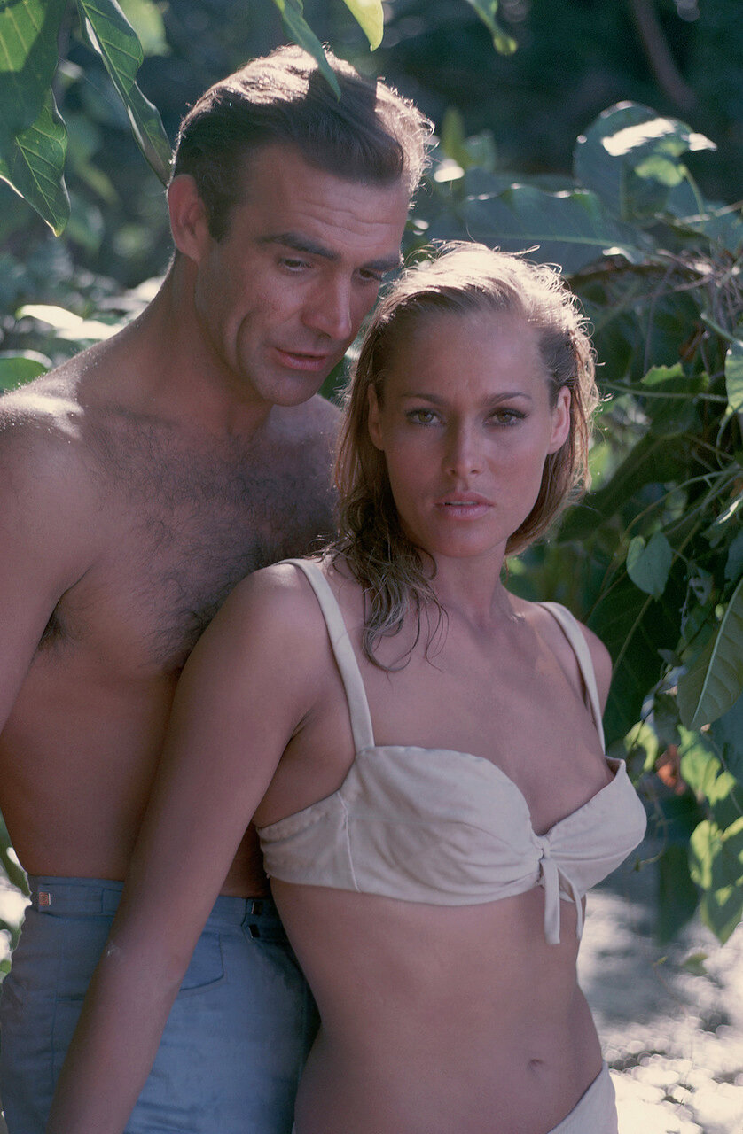 ca. 1962, Jamaica --- Actors Sean Connery and Ursula Andress stand together in Jamaica during the filming of <Dr. No.> --- Image by © Bradley Smith/CORBIS