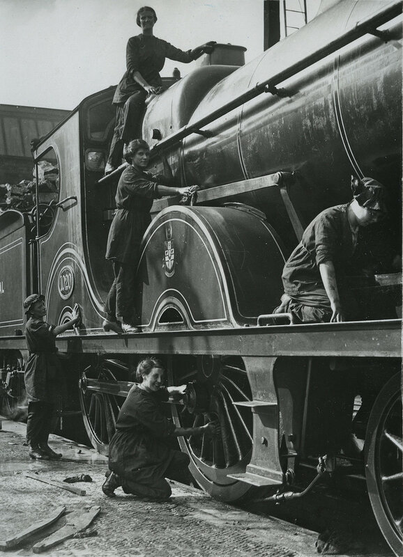 British women cleaning locomotive in Midlands