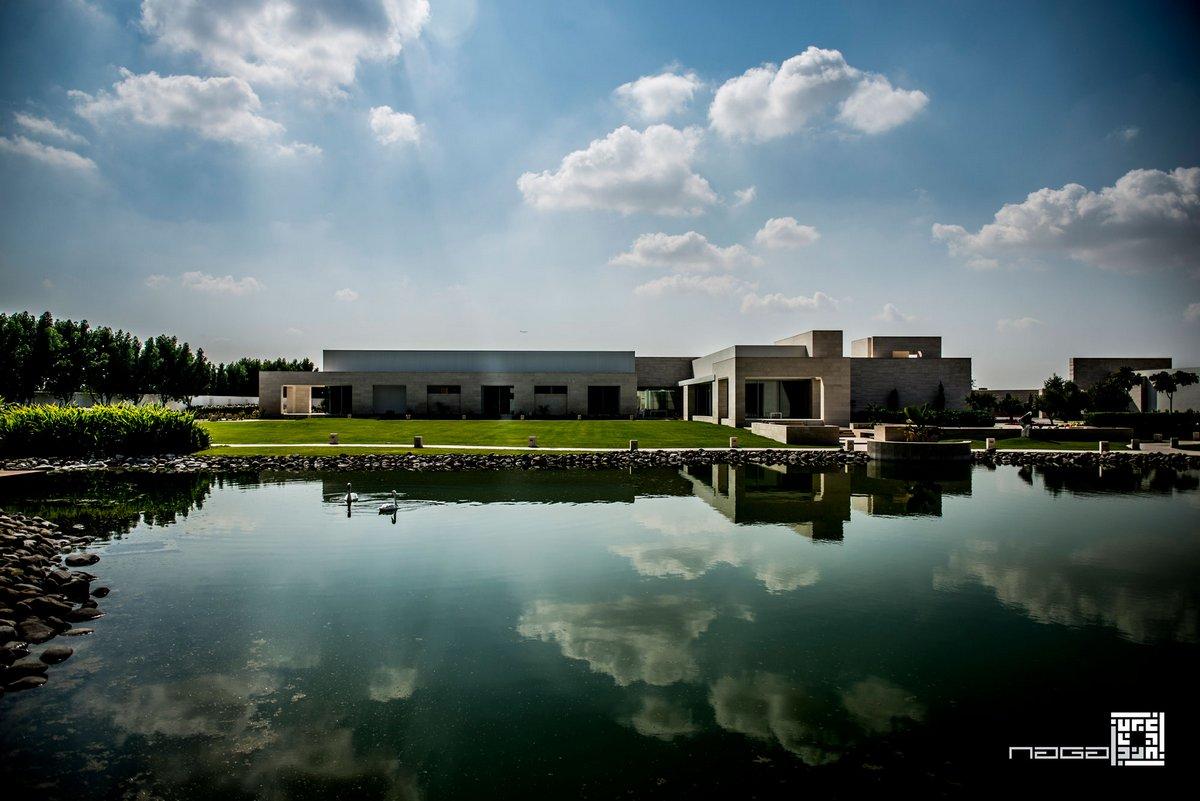 Dar Al Gurair, частный дом в Дубаи, элитная недвижимость в ОАЭ, NAGA Architects, частный дом с бассейном, строгий интерьер в частном доме