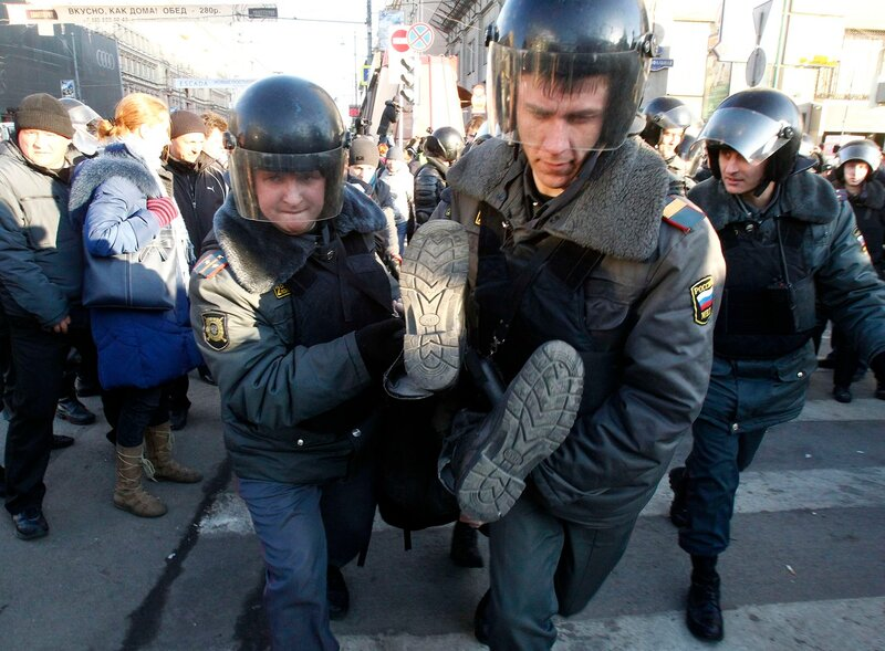 Police officers detain an activist during a protest rally to defend Article 31 of the Russian constitution, which guarantees the right of assembly, in Moscow