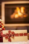 Christmas gift by fireplace