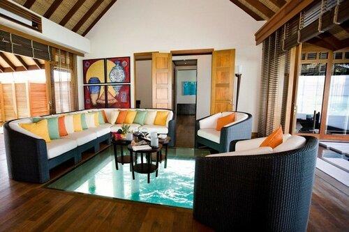 Fantastic glass floor Colorful sofa cushions Curve shaped sofa Artistic wall mural