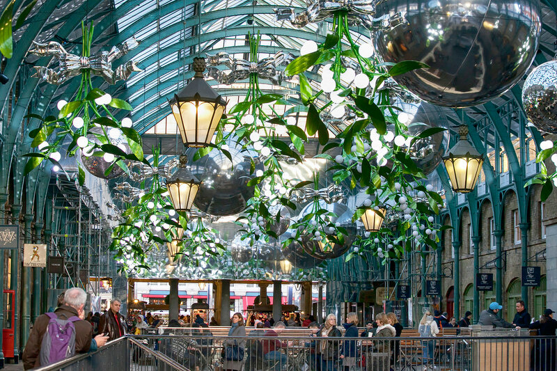 London - November 11, 2016: Christmas Lights are appearing all over the city. This is Covent Garden Market.
