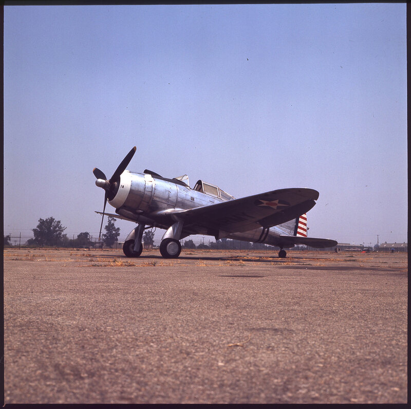 One-quarter left side view of Seversky P-35A (s/n 41-17468) on the ground.  This is the squadron commander's aircraft from the 17th Pursuit Squadron (PS).